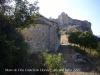 Església de la Mare de Déu del Castell de Llorenç – Camarasa - Al fons de la fotografia apareix la penya on dalt de tot hi ha les restes del castell de Llorenç