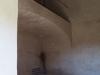 Església de Sant Cebrià dels Alls – Cruïlles, Monells i Sant Sadurní de l'Heura-Fotografia de l'interior de l'església, obtinguda introduint l'objectiu de la màquina de fotografiar per entremig de les barres de ferro de la porta d'entrada