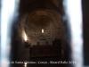Església de Santa Cristina – Corçà - Fotografia de l'interior, obtinguda situant de manera força precària l'objectiu de la màquina de retratar entre mig de l'obertura que permeten les barres de ferro que hi ha a la porta d'entrada