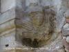 """Capella de Sant Genís – Palau-solità i Plegamans - ... """"En un angle exterior, mig ocult, hi ha la figura d'un àngel amb una inscripció."""" ..."""