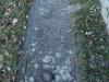 Ermita de Sant Llorenç Dosmunts – Rupit i Pruit - Làpida situada al davant de la porta d'entrada.