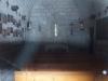 Església de la Mare de Déu de la Torreta – Montmajor - Fotografia de l'interior de l'església obtinguda de manera força precària, adossant l'objectiu de la màquina de fotografiar a la reixa que protegeix una finestreta de la porta d'entrada