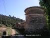 Església de Sant Joan Sesrovires. Al fons de la fotografia, apareix el Castell de Subirats.