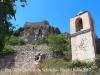 Església de Sant Llorenç de Selmella – Pont d'Armentera - Al fons apareix un llenç de muralla del castell de Selmella.