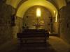 Església de Sant Miquel del Corb – Les Preses -Fotografia obtinguda introduint l'objectiu de la màquina de retratar a través de les barres de ferro de la porta d'entrada.