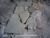 Església de Santa Creu de Palou – Mura - Interior - Al terra hi ha les restes trencades d\'una antiga làpida.