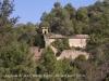 Vistes de l\'Església de Santa Creu de Palou des del camí d\'accés al Mas Farell.