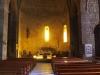 Església parroquial de Sant Esteve – Bagà - Fotografia obtiunguda a través del vidre que separa l'església del cancell d'entrada.