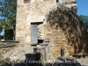 Església parroquial de Sant Esteve – Cornellà del Terri - Per la porta mig oberta es veuen uns quants nínxols del cementiri