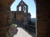 Església parroquial de Santa Maria – Fonolleres / Emmarquen aquesta fotografia les parets del pas que hi ha sota de la torre de l\'homenatge del castell de Fonolleres.
