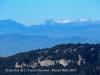 Vistes des de l'Avenc - Al fons, al mig de la fotografia, la inconfusible silueta del Pedraforca