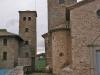 A l\'esquerra veiem la torre del Mas La Garriga. A la dreta l\'església de Sant Joan de Bergús.